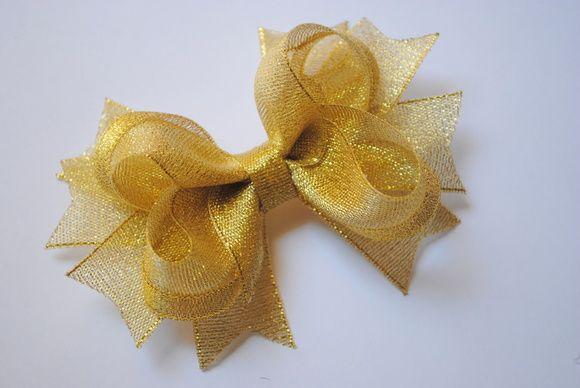 Laço de boutique grande dourado metálico tam aprox. 12cm X 9cm bico de pato (jacaré) importado  Também em prata R$ 20,00