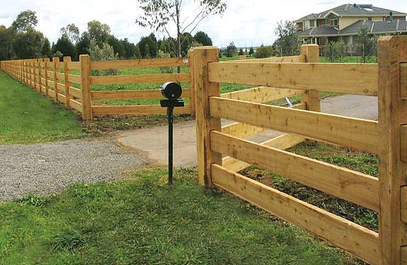 Click on image to go back - Post and 4 rail fence constructed with cypress pine