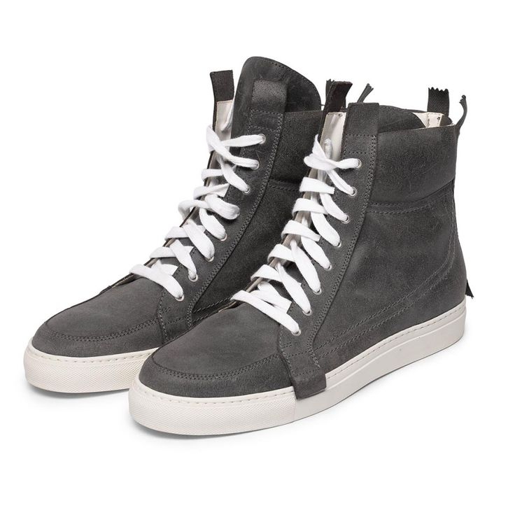 Kris Van Assche Dark Grey Leather Hi-Top Sneakers. From the cool Belgium designer come these multi lace-up sneakers. Featuring a dark grey leather with centre back zip detail and white laces. Perfect for making a ...