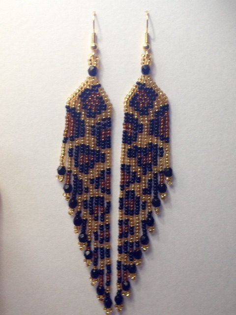 These dramatic earrings are almost 5 inches long. They are very lightweight and hang beautifully. This is my original design and Ive used size 11 seed beads and Czech fire polished end beads. They hang from gold plated fish hook style ear wires.