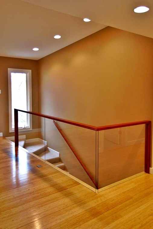 A minimalist glass stair railing from a frontenac mo remodel add recess lights above stairs and window by front door