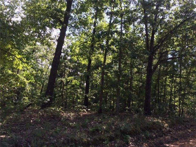 2.44 acre lot in town, located across from Lake Lucerne. Small creek running in front of property in Eureka Springs AR