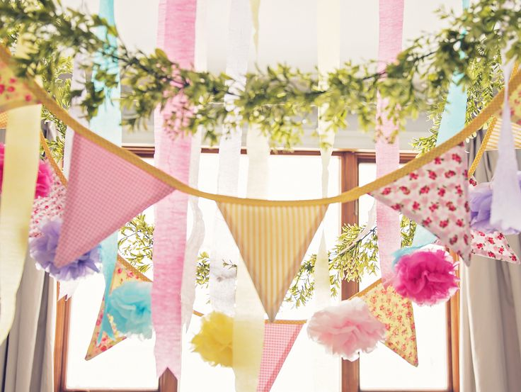 Flag banner from a Trolls Inspired Birthday Party #trolls #flagbanner #pompoms