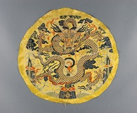 Imperial Embroidered Roundel Made in China, Asia Kangxi Period (1662-1722), 1662-99 Artist/maker unknown, Chinese, re-used in Tibet for ritual purposes Silk damask with supplementary silk weft Image: 14 1/8 x 13 1/4 inches (35.9 x 33.7 cm) Overall: 15 3/4 x 15 inches (40 x 38.1 cm) Currently not on view 2005-92-16 Gift of Jeffrey C. and Carol B. Blank, 2005