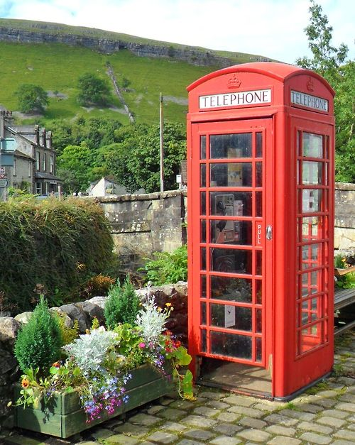 Red Telephone box and flowers, Kettlewell, Wharfedale, Yorkshire Dales, England.    by http://vwcampervan-aldridge.tumblr.com
