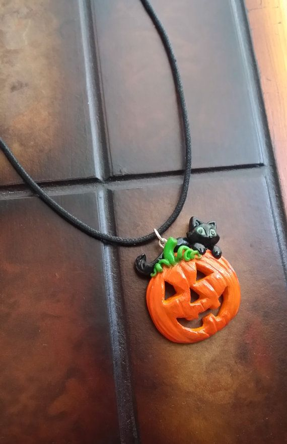 Check out this item in my Etsy shop https://www.etsy.com/listing/246688809/halloween-pumpkin-and-black-cat-pendant