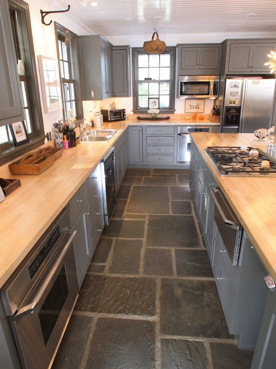 Butcher block counter - Kitchen. I'm more interested in the stone floor