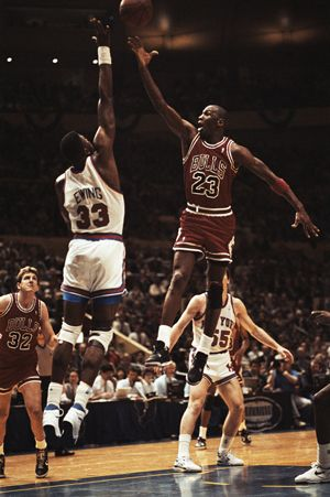 Michael Jordan goes up and over Pat Ewing