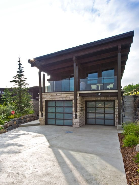 Exterior, Brown Door Frames Wooden Ceiling Panels Glass Railing Stone Wall Cement Walkway Some Photos Of Modern Garage Door Revit To Inspire You: Some Photos of Modern Garage Door Ideas To Inspire You