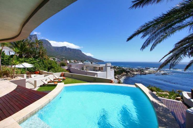 The ultimate stylish and elegant seaside holiday luxury accommodation of the highest standard is offered at Villa Dolce Vita situated in Camps Bay one of Cape Town's most beautiful cosmopolitan beachfronts. Features: • 6 Bedrooms • 7 Bathrooms • Sleeps 12 • Balcony • Air-conditioning • Pool • Beach view • Sea view • WiFi #Travel #Cape #Town #Luxury