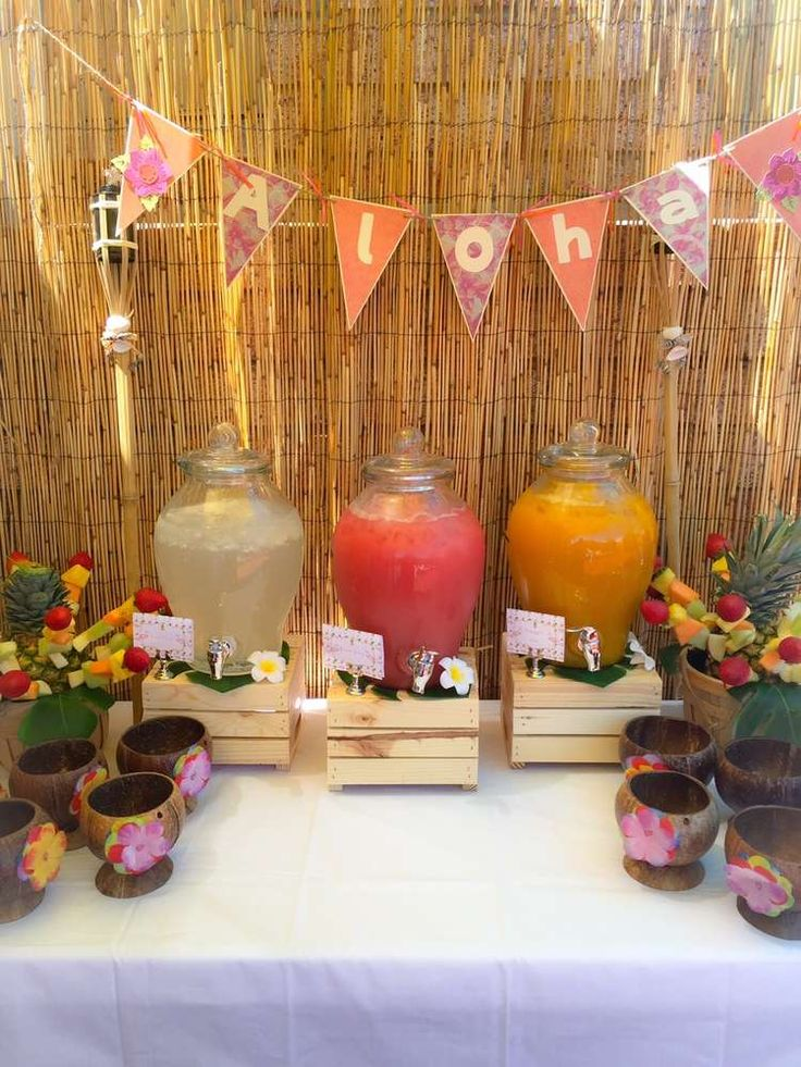 See these Luau cups finished with paper flowers?  Also, dont forget the bamboo background - everything in the photo speaks to the theme.