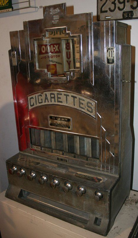 Vintage Cigarette Dispensing Machine.  Look great in a man cave.