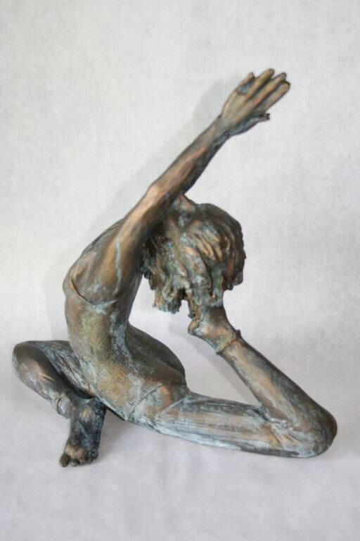 Pigeon pose using white earthenware clay with a bronze patina.  See more one of a kind, hand built sculptures at barbarademaire.com