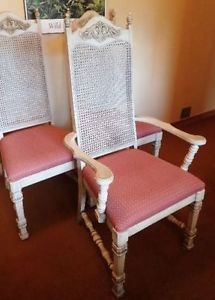3 cream cane-backed dining room chairs