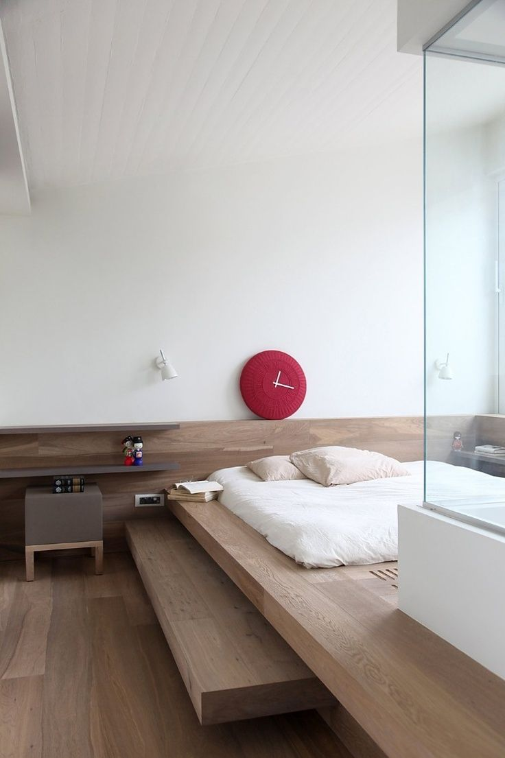 Futon Instead Of Bed Red Clock Accent Wooden Floor Nice