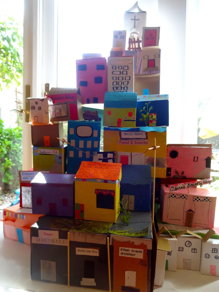 """Cardboard City"". My kids made houses, stores and businesses that showcased their interests! We had all the materials (boxes, paint, paper, wire, sticks, glue) to make shutters, doors, roofs, windows.  GREAT multi-kid project for Art Show. Ages 5-10."