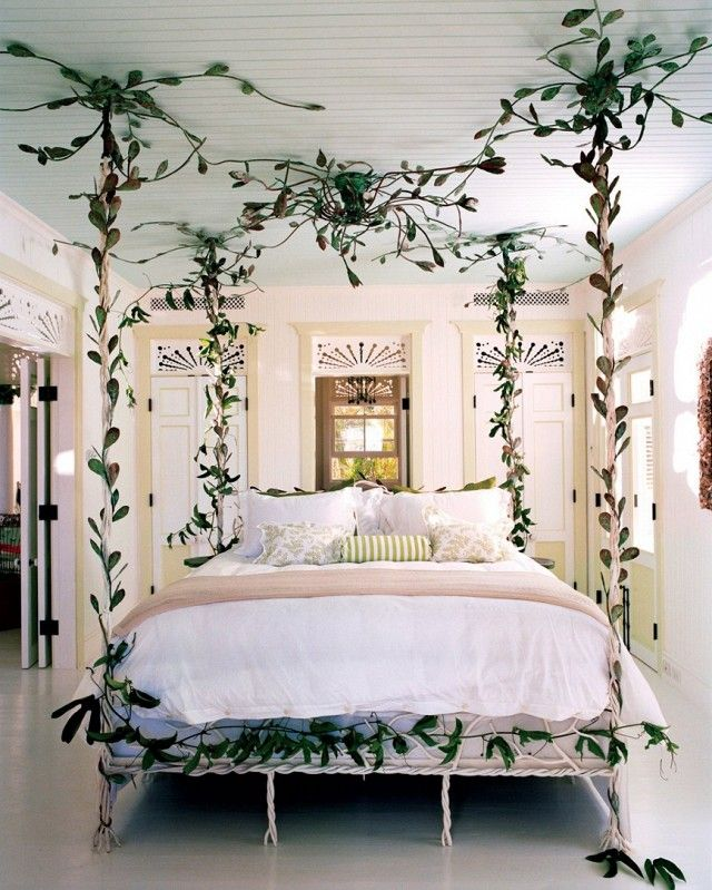 Whimsical bedroom with a canopy bed made of greenery