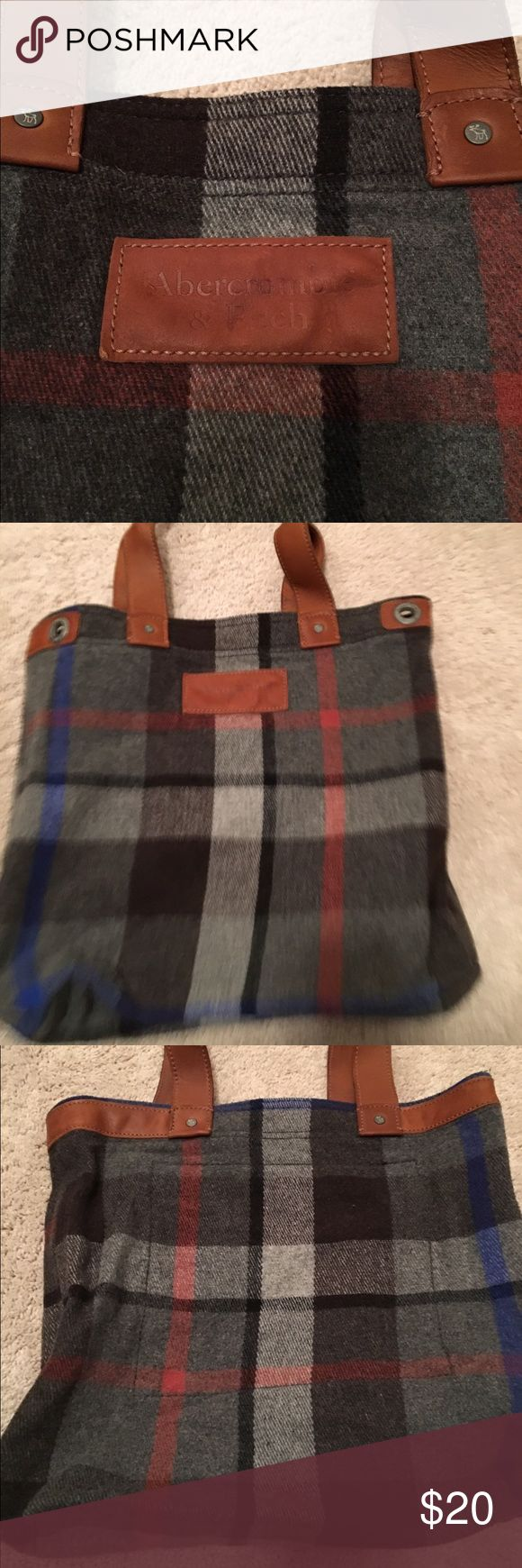 Abercrombie and fitch tote faux leather accents Great condition plaid tote with faux leather accents. Abercrombie and fitch. Make an offer. Also have a brown tote in closet Abercrombie & Fitch Bags Totes