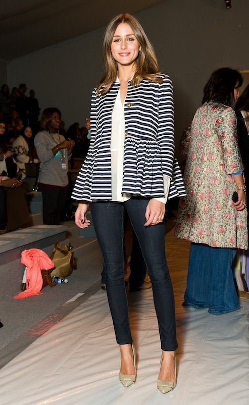 Olivia Palermo in the Tibi peplum jacket, dark blue skinny jeans, and Mulberry's stitched bow pumps