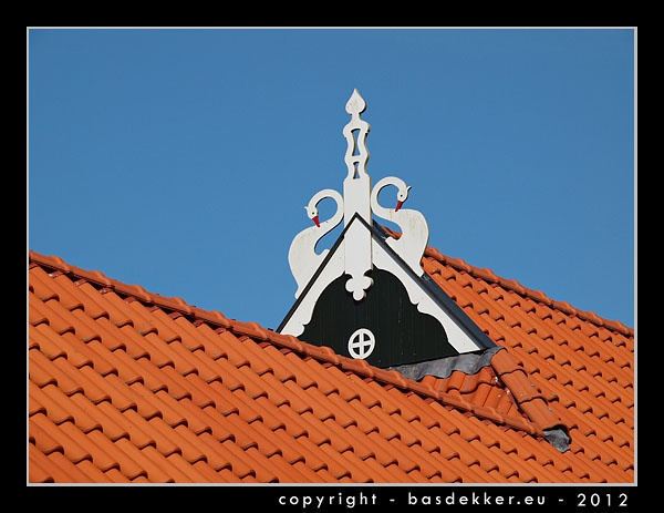 Typical Frisian rooftop decoration with swans.