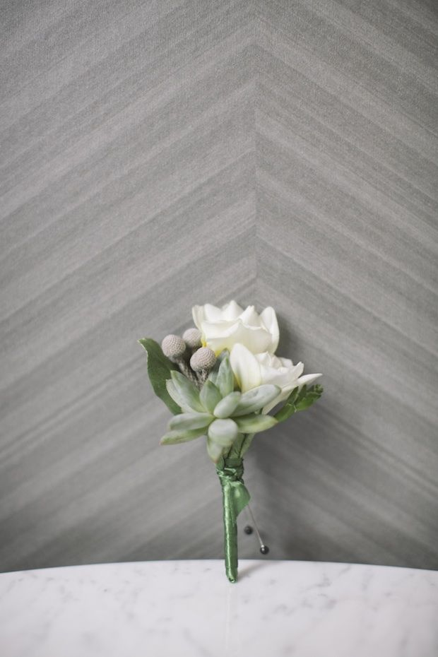 white freesia, brunia berries, succulent boutonniere
