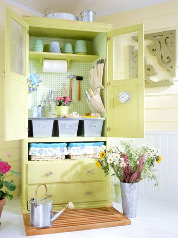 Garden Shed:  Plant this armoire anywhere inside to provide an organized potting place. Show off painted terra-cotta pots in upside-down stacks on a high shelf. Secure a paper-towel holder under the shelf for quick cleanup. Bottom drawers can hold anything from books and magazines to knee pads and hats. Remove one drawer and use the shelf to store fabric-lined baskets that hold bulbs and seeds.