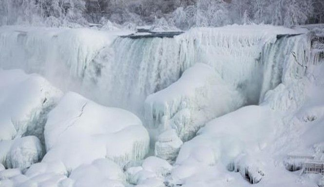 Niagara Falls has frozen over as arctic temperatures have taken hold across the Great Lakes, creating an amazing sight that's generating some viral photos and