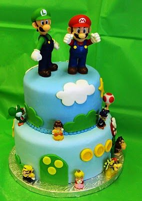 Mario Cake -- two tiered blue fondant cake with figurines and more fondant decor.