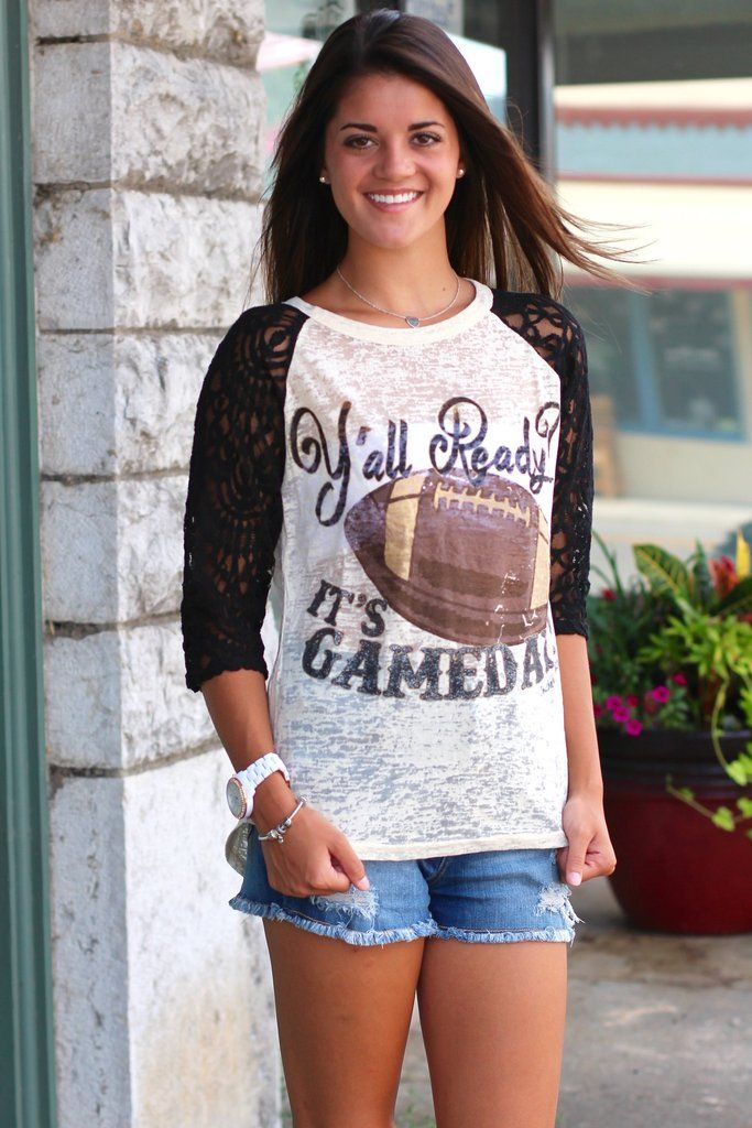 "Ya'll ready for some football? Our ""It's Gameday"" raglan featuring black lace sleeves and a burn out body is too cute! Features glitter on the writing on ""It's Gameday"" and a large football graphic. Model is wearing an off white bandeau underneath. Model is 5'9"" pant size 2 wearing size small. True to size, but if you are chesty, then size up. Generally, it runs like a t-shirt.  S(0-4) M(6-8) L(10-12) XL(14) 2XL(16) 60% Cotton. 35% Polyester. 5% Spandex."