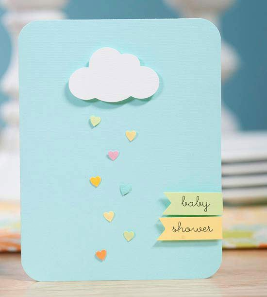 """These simple shower invitations look great -- and only take a few minutes to make! Fold a light blue piece of scrapbook paper in half, and round the corners with a corner rounder tool. Make a cloud shape with a paper punch and adhere using adhesive foam. Punch small hearts from different colors of paper and adhere below the cloud for raindrops. Write """"baby shower"""" on strips of colored paper; adhere to the bottom right-hand corner of the card using adhesive foam for a dimensional effect."""