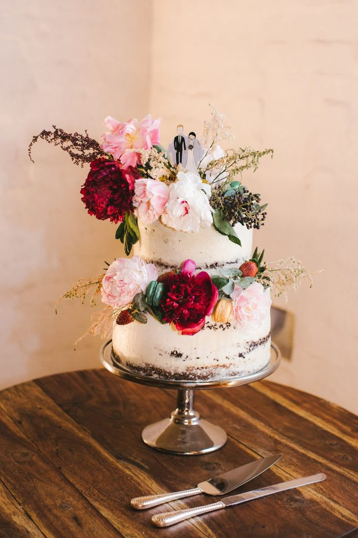 simple two-tiered wedding cake with fresh flowers