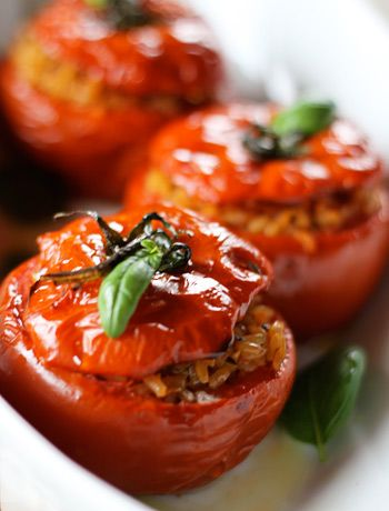 great starter for dinner parties, could also use peppers - Risotto Stuffed Tomatoes