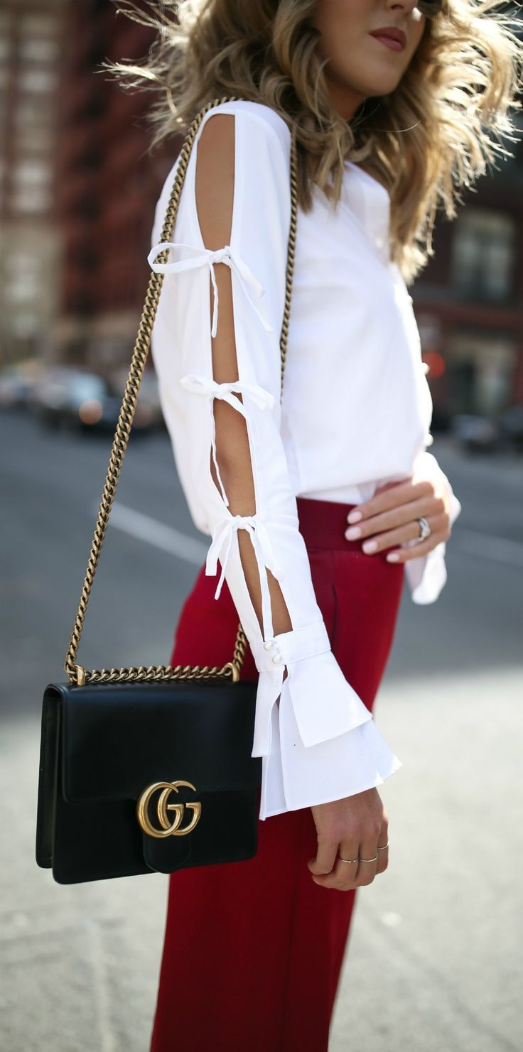 Top 10 Spring Trends to Know // #8: How to Wear Statement Sleeves // click the image for all the details! // white collared button down shirt with split tie sleeve detailing and bell sleeve cuffs, ruby red silk shiny satin wide leg pants, black suede low block heel sandals, gucci gg cross body chain bag and cat eye mirrored burgundy sunglasses {jonathan simkhai, alice olivia, steve madden, net-a-porter}