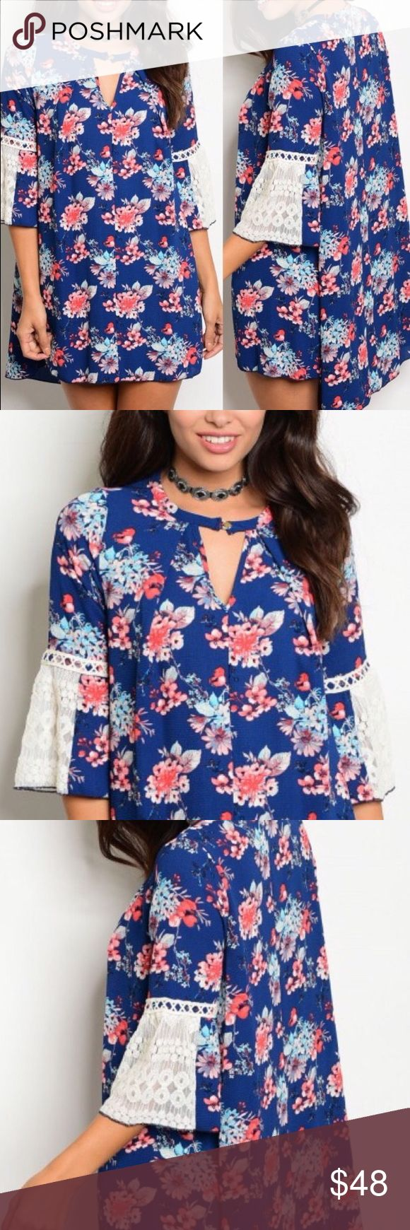 New ArrivalNavy Floral Bell Sleeve Dress This dress is awesome! Navy background with a flower pattern. The sleeves are embellished with lace. Choker look without the choker feel! 97% polyester 3% spandex Buy single piece or add to a bundle for savings at purchase. No trading. Price is firm. Boutique Dresses Mini