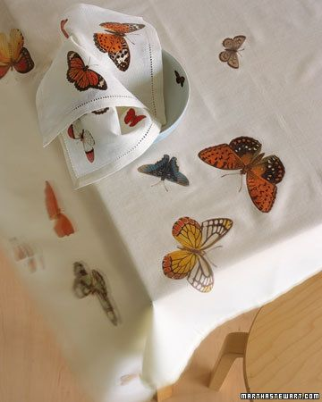 Butterfly Table Linens    These cream-colored linen tablecloths and napkins are embellished with iron-on transfer paper on which we printed clip-art butterflies. You can make your own using the image of your choice and a color printer.