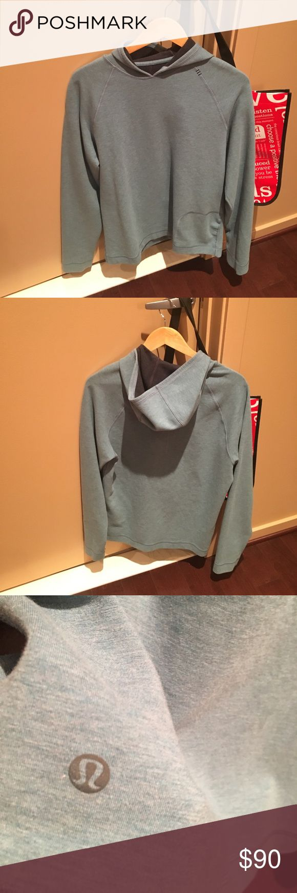 Men's size M blue/gray Lululemon hoodie never worn Cut tags but never worn. Comes with bag. lululemon athletica Shirts Sweatshirts & Hoodies