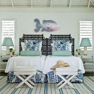 One handcrafted fish sculpture gives so much character to this coastal bedroom.