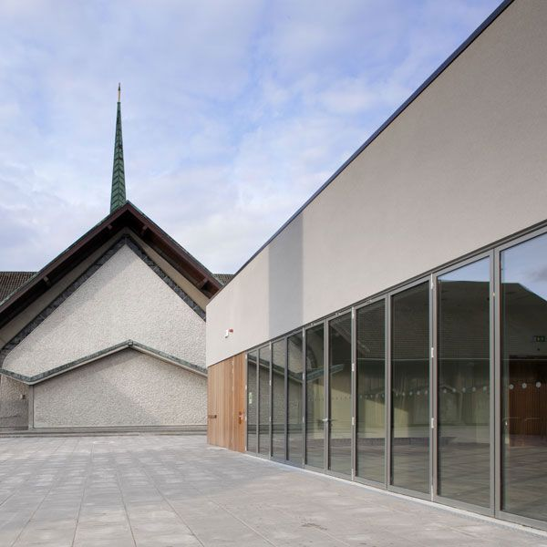 There is an image of their furbished building on the panels in context with the church. The layouts have been improved and rationalised and arranged around the retained pitched roof main hall area which mimicked the church