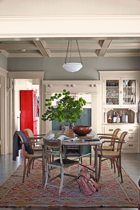 The owner of this California cottage hired someone to craft this table from reclaimed fir, and purchased a set of flea-market bentwood chairs for $60.