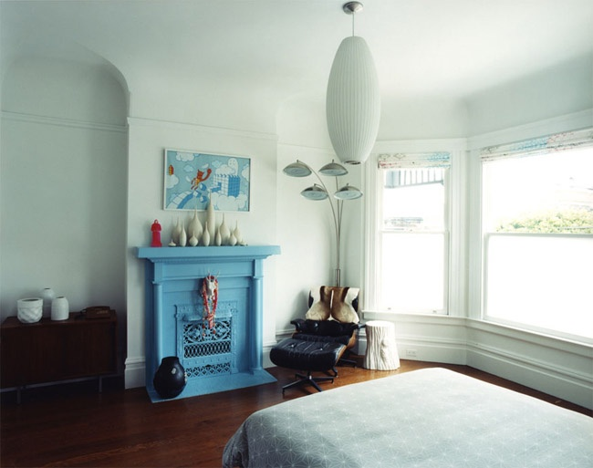 blue painted fireplace and nelson lamp bedroom|envelope A+D