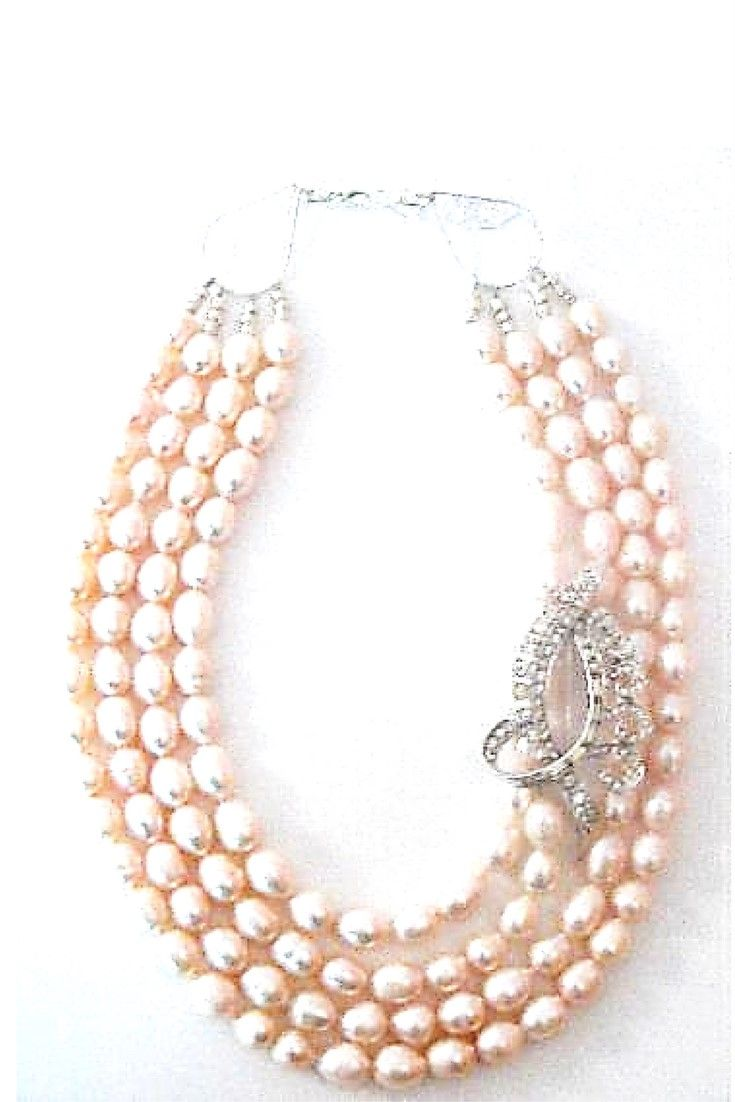 Pink Freshwater Pearls & Vintage Brooch necklace.  One-of-a-kind statement necklace. Handmade with pink freshwater pealrs paired with vintage brooch $275,00. #freshwaterpearl#statementnecklaces#necklaces#handmadenecklace