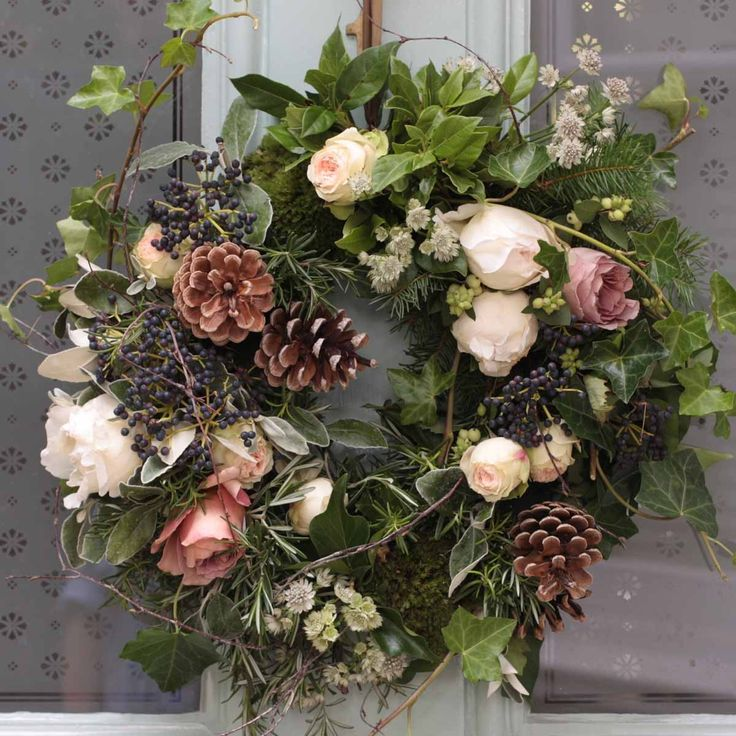 Luxury Woodland Door Wreath - the ultimate welcome to adorn Christmas door this year. This luxury wreath offers heavenly scented cream piaget, caffe latte and pavlova roses arranged with rich ivy trails, berries, birch twigs, rosemary finished with astrantia and fir cones. Once the flowers have faded the herbs and foliage will continue through the festive season.