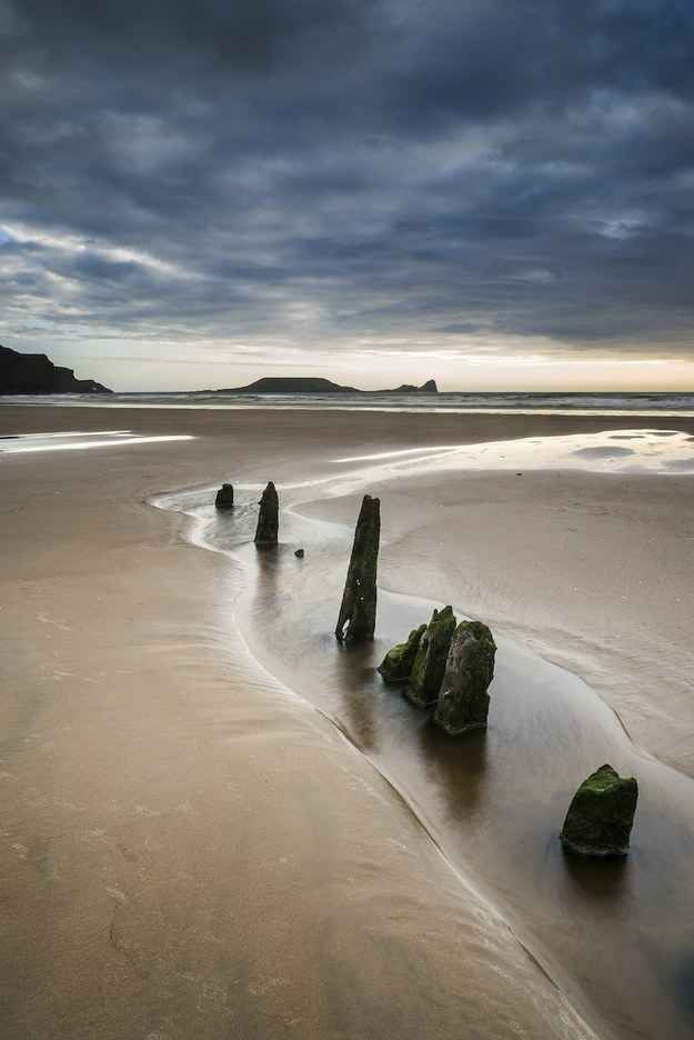 Another great place to go camping in the UK, if you can handle the bad weather! Rhosilli Bay, Swansea, Wales