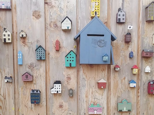 Some house shaped wood decorations on the wall at Gamcheon Cultural Village  #Gamcheon #Busan #Southkorea