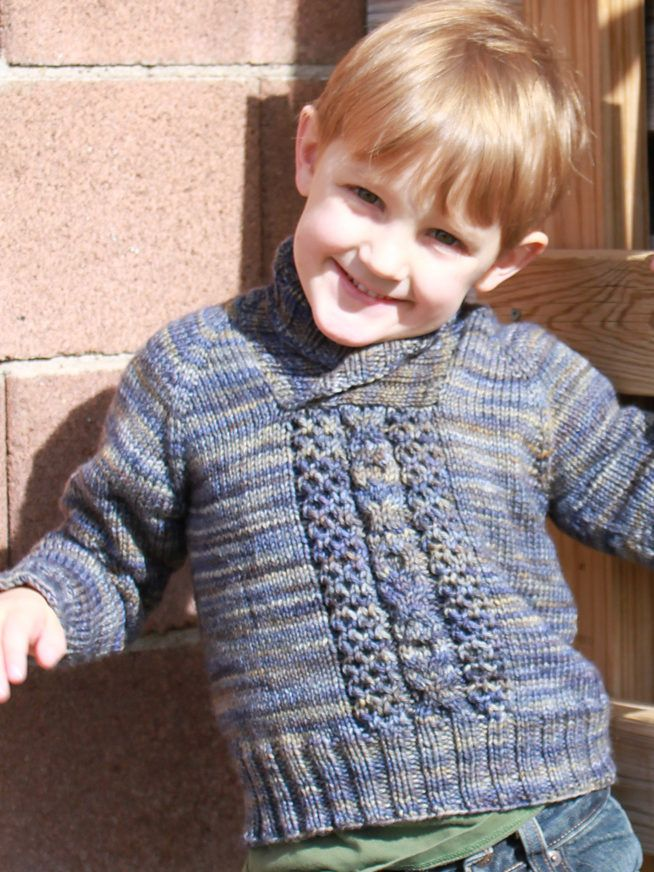 Free Knitting Pattern for Child's Cable Pullover - Long-sleeved sweater with shawl collar and center cable panel with XOXO pattern. Sizes 2, 3, 4, 5, 6, 8, 10. Worsted weight yarn. Designed by Amanda Woeger