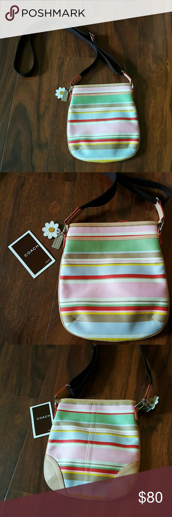 Coach purse satin stripe cross body  handbag Pastel stripe satin  authentic COACH cross body purse, it have front pocket. It closes with a zipper. Never use, no tags.Only care instructions. Coach Bags Crossbody Bags