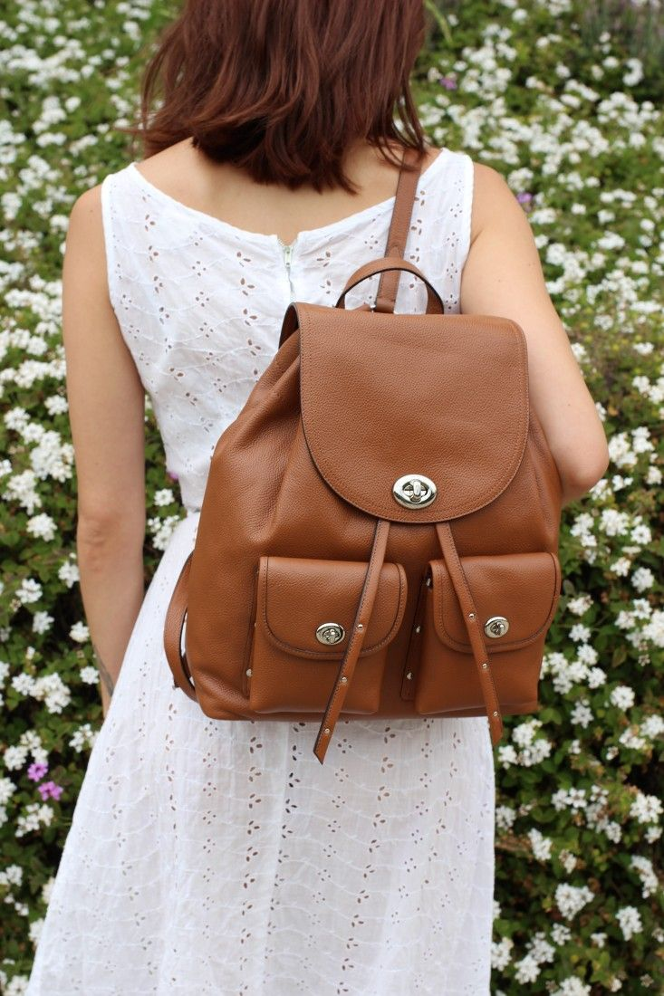 The Turnlock Tie gives this Coach saddle brown backpack a feminine touch. #Ad