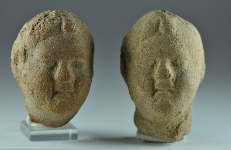 Roman Egyptian terracotta heads of Young boys Harpocrates head, 1st century B.C.-1st century A.D. Roman Egyptian hollow moulded terracotta figure depicting two young boys. Private collection