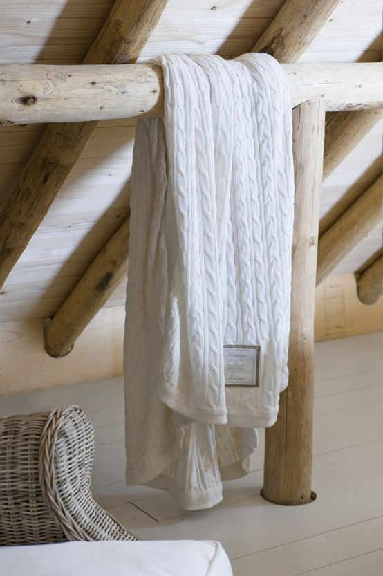 White throw with beautiful wood beams.