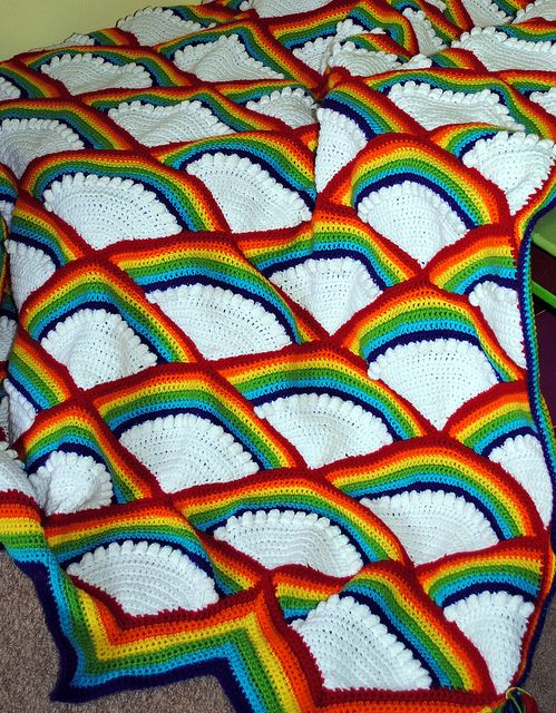 Rainbow Afghan Crochet:  It says there is a pattern, but the link is broken.  BUT this looks pretty simple enough to attempt on your own-I would use more of a shell type stitch, or all puff stitch for the cloud portion.  Certainly worth a shot.